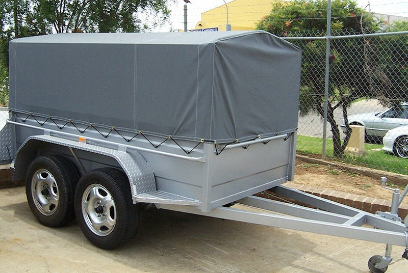 Tandem trailer With High Sides and Canopy Cover